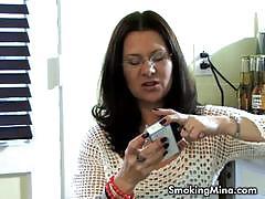 Brunette milf mina gorey smokes and provokes