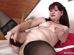 Redheaded mom enjoys a young cock