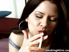 Brunette bitch smoking and touching her cunt