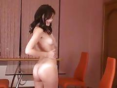 Victory sits on a chair and strokes her clit