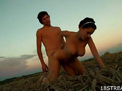 Busty teen hammered at a farm