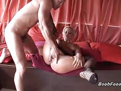 Blonde milf sucks two hard cocks and gets banged