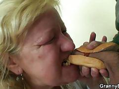 Blonde mature grandma enjoys a hard young cock