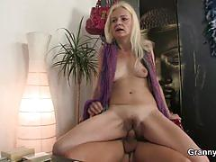 Blonde granny sucks and rides a hard rod of meat