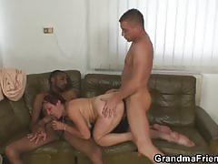 Mature cougar having fun on two huge dicks