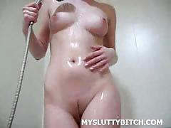 Teasing amateur soaping her precious body