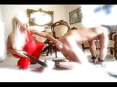 Blonde mistress whipping her obeying slave