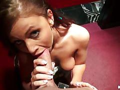 Horny babe sucks cock in a changing room.