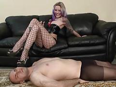 Alt mistress steps on her slave with heels on