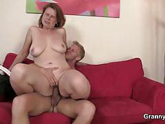 Busty mature babe sucking and fucking a young cock