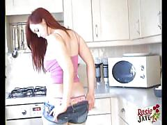 Teen redhead rosie jaye strips in the kitchen