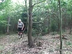 Pissing granny sucking grandpa's cock outdoors