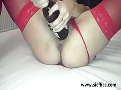 Hot brunette milf fucks herself with huge toys