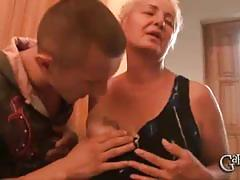 Busty blonde mature sucks two cocks