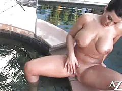 Babe in bikini masturbates by the pool