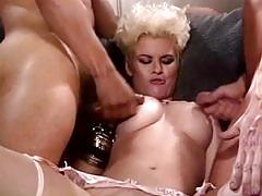 Vintage blonde slut enjoys two hard cocks