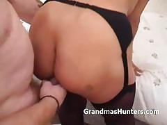 Blonde granny sucking and fucking an eager cock.