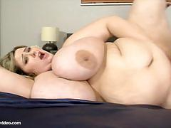 Bbw mandy majestic rides a black cock on the bed.