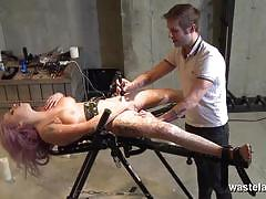 Restrained sex slave gets burned and vibrated