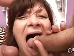 Busty granny deepthroats two young cocks