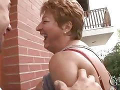 Lusty granny blows two cocks