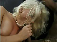Blonde milf gets banged hard by two black studs