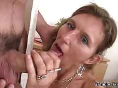 Horny old bitch enjoys two dicks