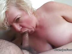 Sweet mature couple having sex in their couch