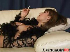Sexy smoker yasmine rubs her shaven pussy