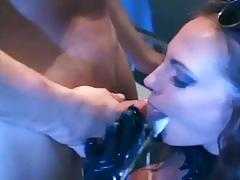 Busty brunette in a latex costume gets fucked hard