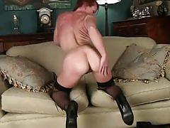 Redhead lusty bitch rubs her clit and masturbates.