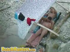 Nude lovers at the beach doing naughty things