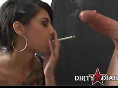 Brunette babe stuffs mouth with a cock and smokes.