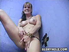 Anjelica plays with black cock through glory hole