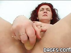 Red-haired mature dildos her sweet pink cunt