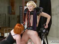 Ginger dominatrix dildos her blonde slave's pussy