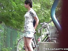 Hot asian girl pissing on the bicycle store