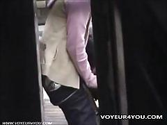 Young japanese couple getting dirty on the street