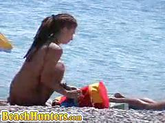 Hidden cam caught bootylicious babes nude on beach
