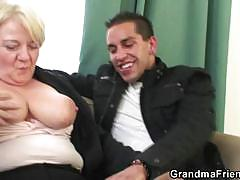Busty blonde grandma enjoys two hard cocks