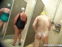 Horny sluts get caught taking a shower