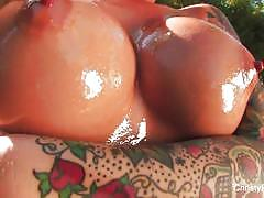 Christy mack oils her ass and poses in the garden