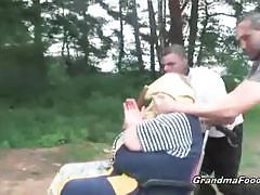 Helpless granny forced to fuck two thugs outside