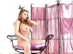 Blonde beauty teases in white lingerie