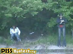 Ladies pissing outdoors get caught on hidden cam.