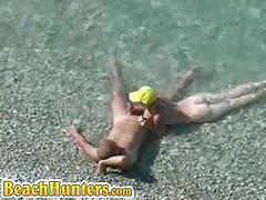 Spycam caught horny couples fucking at the beach