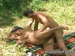 Chunky granny riding dick while having picnic