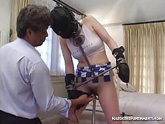 Chained oriental cheerleader gets dildoed