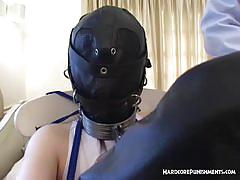 Chained and hooded asian slut gets masturbated