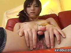 Asian beauty toys her pussy